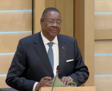 Malawi President speaking in front of the Scottish Parliament